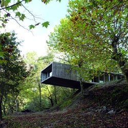 An amazing concrete house, cantilevering over a cliff in Portugal by Graça Correia and Roberto Ragazzi.