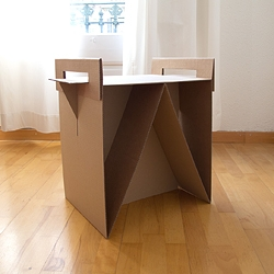 Adrian Candela's Nit is a cardboard nightstand or side table that gives a second life and purpose to the boxes that originally held your furniture.