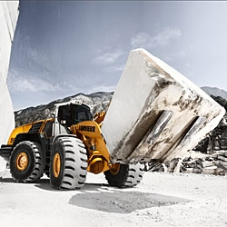 Liebherr L 586 wheel loader in the famous marble quarry in Carrara, Italy. This photo is taken from the Heavy Equipment 2010 calendar, presenting impressive motifs of monster machines.
