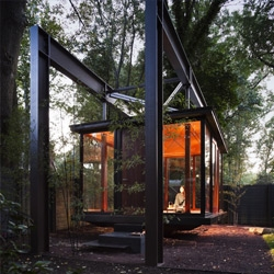 This Tea House by David Jameson makes an unusual and ephemeral addition to a suburban Bethesda backyard - its bronze and glass volume floats over the grass like hanging lantern.
