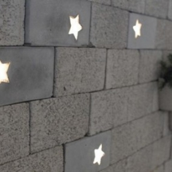 Star-shaped light embedded in a concrete block by NOTHING dESIGN. A perfect addition to your boring brick wall.