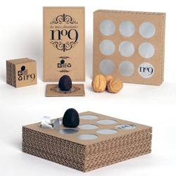 Here's Thomas Jonkajtys' work in my packaging class. First, a mold was designed in a nut shape. The package is designed out of laminated layers of corrugated board. A break through metallic sheet protects the nine chocolates.