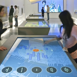 NYC: touch-sensitive interactive tables and interactive kiosks with virtual maps from Google Earth are being placed in the city.