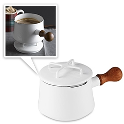 Dansk Kobenstyle's mid century enamelware pots have been making quite a comeback - Williams Sonoma has an exclusive on the adorable white 1qt size! Love the teak handle and that the lids can double as trivets!