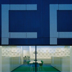 OFFECCT headquarters, factory & showroom- The building facade is transformed by placing 16,647 plastic insert feet presenting the company logotype onto the building's perforated steel wall.