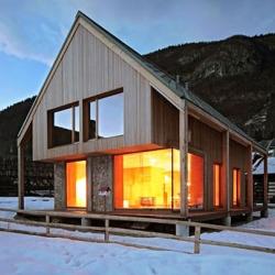Ofis Arhitekti just finished work on this beautiful modern reinterpretation of a classic alpine Chalet.