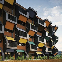 A colorful social housing complex in Slovenia by OFIS arhitekti