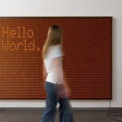 'Hello World' by Valentin Ruhry had the brilliant idea to take 5,000 of the orange rocker switches normally seen in surge protectors, power strips, and transform them into a blank canvas on which to scrawl words.