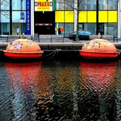 Artist and architect Denis Oudendijk turned these oil rig escape pods into an amazing floating hotel in the Netherlands.