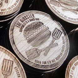 Beautiful curved woodwork and laser etched wooden nickels.. all made by Knowhow Shop LA for Los Angeles's slow fast food mecca The Oinkster.