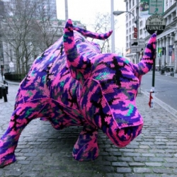 Crocheted Olek (AKA Polish-born, NYC-based Agata Olek) crocheted Wall Street's Charging Bull in a cool piece of installation art that only lasted two hours before being taken down.