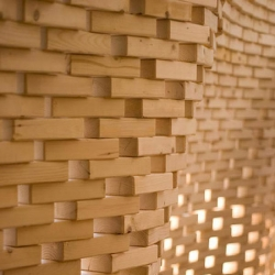 Currently on display, a digitally generated and fabricated wall consisting of wooden bricks - the outcome of a synthesis of computer generated design and computer aided construction research at the GSD.  The Project is the outcome of a synthesis of computer generated design and computer aided construction research at the GSD