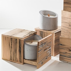 INSEK Design Concrete Candles - Individually hand cast concrete vessels filled with soy wax in seasonal scents. Each candle comes in a reclaimed wood box with a seed paper card and instructions for planting in the vessel after burning.