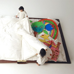 Child's Play by Yusuke Suzuki  is a page turner of a bed that looks like an oversized book. At night it is opened up to sleep in and during the day it is shut closed to create enough space for children to play in their room.