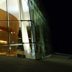 Walking on the roof of the Oslo Opera House at night.