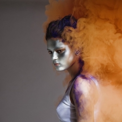 Lacey is a British photographer doing some interesting things such as this set using brilliant powdered colour.