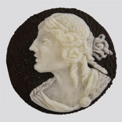 Judith Klausner (who brought us embroidered toast) also creates beautiful cameos carved from Oreos!