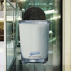 The traditional dunk of Oreo cookie into a glass of milk demonstrated by a panoramic elevator