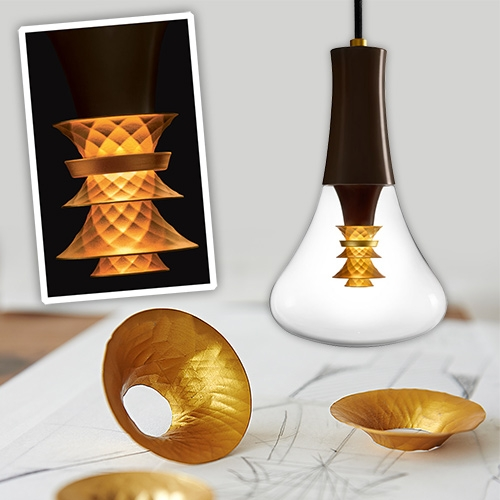 The new Plumen 003 LED bulb and pendant. The beautiful golden faceted center disperses a warm ambient glow while also providing a downward spotlight.