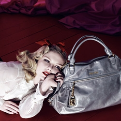 Beautiful new ad campaign for Miu Miu Spring 2008 with Kristen Dunst~ particularly smitten with the ominous surreal reds of the backgrounds in contrast with her very pale look... and some great bags and shoes!