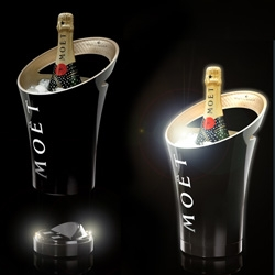 Jean Marc Gady for Moet & Chandon ~ luminous ice bucket that lights up when placed on its base... could a bottle of champagne stand out any more in dimly lit lounge?