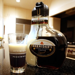 Sheridan's Coffee Layered Liqueur ~ finally tracked down a bottle, and it is still the coolest bottle design yet. The two separate black and white filled glass bottle share a cap, which pours perfectly layered drinks.