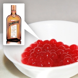 Cointreau Pearls! These have strawberry infused and can be served alongside margaritas, or floating in champagne... they are also made with gold flake infusions! See more pics and videos!