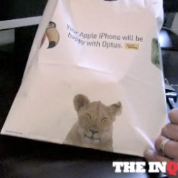 Duncan Riley at The Inquisitr  (australian) has a video of his unboxing of a white iPhone... i'm loving the animals on his bag!