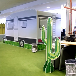 Wat Design transformed ILSE's offices into a crazy life size pixel paradise, from trailers to sunsets, and even a pixel window in the men's room.