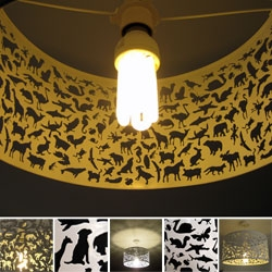 BEASTIES!!! Up close with the Habitat lamp shade ~ Acid etched metal shade featuring animal-shaped silhouettes etched around the shade.