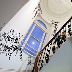 On fascinating juxtapositions, at The Dock in london, within the white house the contrast of black vinyl flora and fauna against the ornate ceiling and wrought iron staircase