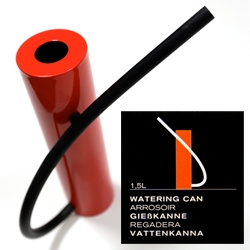 Born In Sweden Watering Can ~  designed by Pascal Charmolu. A simple stainless steel cylinder with a rubber hose and magnet...