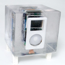Billy Chasen has exploded an ipod, encased it in resin, and plays music off of it. Could you imagine a cooler art piece/present for this season?