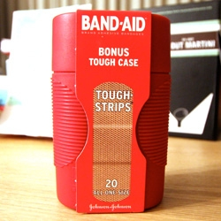 On noteworthy packaging design, i was strangely drawn to this Band-Aid Tough Strips Tough Case