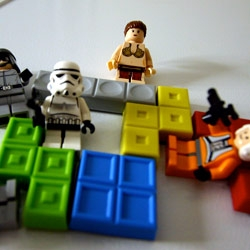 You're never too old for legos. And when all else fails, they are guaranteed to inspire you... here are some lego star wars magnets (with some tetris magnets) ~ a $1.50 duplo dragon... and some lego divers and angler with glow fangs.