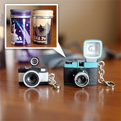 Teeny tiny cameras ~ that come in metal film cases ~ with graphics of rockets and cowboys, what's not to love? Lomography 20% cameras!