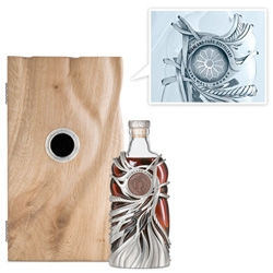 Highland Park 50yo Whisky ~ beautiful hand crafted sterling silver bottle squeezing the glass, complete with hand carved sandstone and a secret inside... designed by Maeve Gillies.