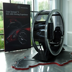 Gran Turismo 5 set up in the Mercedes Benz Bremen Factory Lobby ~ Nürburgring mat with every twist and turn labeled, engine like holder for the PS3, Logitech wheel set up, and more...