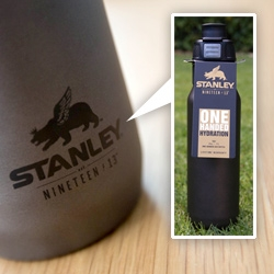 Stanley Nineteen13 Collection 1-Handed Water Bottle. Great logo - crowned bear with wings? Gorgeous minimal collection with nice details ~ and the 1-handed water bottle has a brilliantly simple opening.