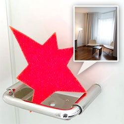 Spitz Hotel, Linz, Austria ~ love the playful red burst of a star logo this designer boutique hotel uses on everything from the sponge in the bathroom to a cut out on the custom steel desk... take a peek inside our room!
