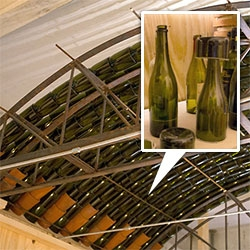 Recycled Wine Bottle Roof ~ cut wine bottles are nested to create a glass catenary rooftop that creates beautiful shadows at the Venice Biennale.