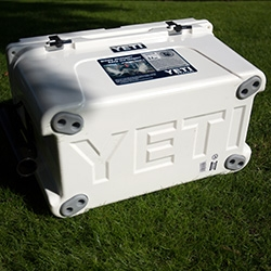 YETI Coolers - beyond this hardcore line of coolers are some amazing design, branding, and packaging details. Here's a close up look at the Tundra 45, SeaDek, Bear Locks, Beverage Holder, and Rod Holder. And Bucky hops in...