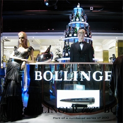 Quantum of Solace ~ at Harrods! They have a Bollinger Champagne Bar, the Aston Martin DBS, the Sunseeker speedboat, Tom Ford suit and black Prada dress worn by Daniel Craig and Olga Kurylenko and the latest Omega...