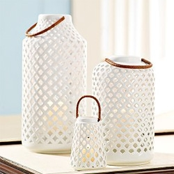 Lynn Lanterns from Williams Sonoma Home are a gorgeous use of porcelain and candles, i wonder what the lighting actually looks like at night!