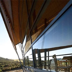 Orokonui Ecosanctuary building in New Zealand by Architectural Ecology.