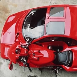 What's it? Car or Motorcycle? It is Laverda motorcycle sidecar, a supercar sidecar, including gulfwing doors.