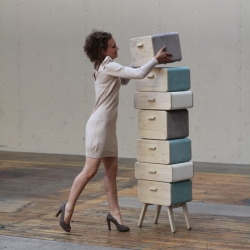 Oturakast by Rianne Koens. A stack of separate storage components with legs that fold out, turning drawers into stool