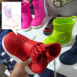 Butler Overboots for kids ~ adorable branding/packaging (penguin logo!) and these overboots are soft and pliable but ready to take on snow, rain, etc and slip on right over your kids' shoes!