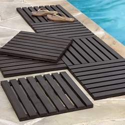Also love the idea of these wood slat tiles ~ instant patio, that you can even store when not in use... or in the bathroom? West Elm ~ 4 for 99$