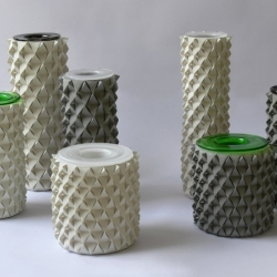 Israeli designer Ofir Zucker in collaboration with origami artist Ilan Garibi, has created the Palmas concrete origami vase collection for Talents Design.
